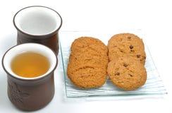Break time. Macro cookies and chinese tea Stock Photos