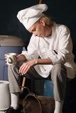 Break Time. Attractive female chef in uniform on a break Stock Images