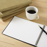 Break time. Cup of cofee,books and pen on wooden desk Stock Photography