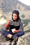 Break time. A portrait with a boy having a break time on the mountain Royalty Free Stock Images