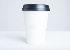 Break time coffee concept with paper cup with plastic top Stock Image