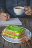 Break time, coffee time with pandan custard cream on toasted, ho Royalty Free Stock Photo