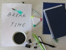 Break Time Concept. Relaxation. Office desk table with notebooks, supplies and coffee cup. Top view. Break time background composition. Top view. Office Break royalty free stock photography