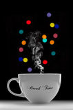 Break Time. Concept with a Cup of Hot Drink Against Colourful Abstract Bokeh Background Stock Images