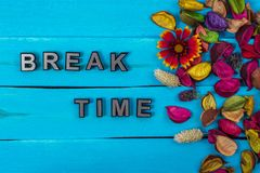 Break time on blue wood with flower stock images