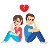 Break Up Couple Sitting. Young couple sitting on floor upset back to back break up concept Royalty Free Stock Image