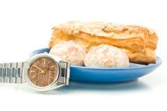 Break - Watch near the plate Stock Image