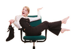 Break from work. Businesswoman relaxing on chair. Royalty Free Stock Image