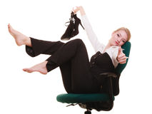 Break from work. Businesswoman relaxing on chair. Stock Photo