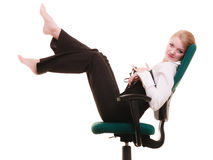 Break from work. Businesswoman relaxing on chair. Royalty Free Stock Photo