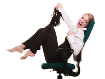 Break from work. Businesswoman relaxing on chair. Stock Photos