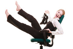 Break from work. Businesswoman relaxing on chair. Stock Photography