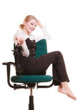 Break from work. Businesswoman relaxing on chair. Royalty Free Stock Photography