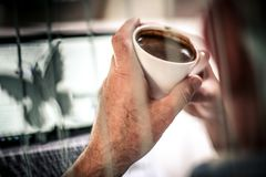 Break on work. close up. Senior business man drinking coffee in office. Close up stock image
