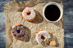 Break at work with coffee and donuts Royalty Free Stock Image