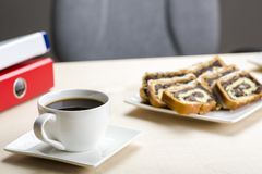 A break at work - time for something sweet. Let`s meet in the office with coffee and cookies royalty free stock photos