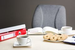 A break at work - time for something sweet. Let`s meet in the office with coffee and cookies Royalty Free Stock Image