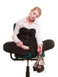 Break from work. Tired businesswoman with leg pain royalty free stock image