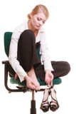 Break from work. Tired businesswoman with leg pain Stock Image