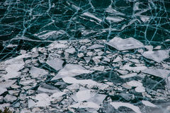 Breakaway ice floes floating in open water Royalty Free Stock Photo
