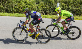 The Breakaway - Tour de France 2016. Quineville,France- July 2, 2016: The cyclists Anthony Delaplace of Fortuneo-Vital Concept Team and Alex Howes of Cannondale Royalty Free Stock Photos