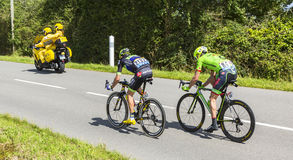 The Breakaway - Tour de France 2016. Quineville,France- July 2, 2016: The cyclists Anthony Delaplace of Fortuneo-Vital Concept Team and Alex Howes of Cannondale Royalty Free Stock Photo