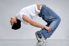Breakdance. R posing on a grey background Stock Photos