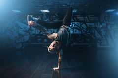 Breakdance action, dancer posing in dance studio. Modern urban dancing style Royalty Free Stock Photography