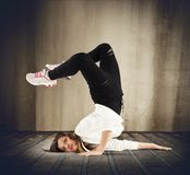 Breakdance girl. Agile dancer in a pose of breakdance Stock Photos