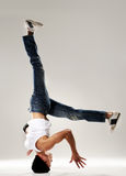 Breakdance head spin. Breakdancer frozen in mid head spin, classic modern hip hop or break dance move stock photography