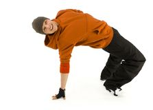 Breakdance make me happy. Young, happy bboy holding up on hand. Looking at camera and smiling. Isolated on white in studio. Side view, whole body Stock Photography