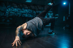 Breakdance motions, performer in dance studio. Modern urban dancing style Stock Photography