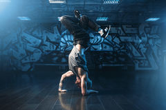 Breakdance motions, performer in dance studio Royalty Free Stock Image