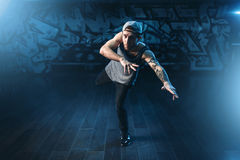 Breakdance motions, performer in dance studio. Modern urban dancing style Royalty Free Stock Photography