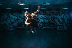 Breakdance motions, performer in dance studio. Modern urban dancing style Royalty Free Stock Photo
