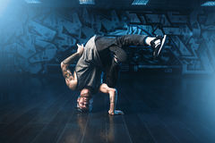 Breakdance motions, performer in dance studio. Modern urban dancing style Royalty Free Stock Image