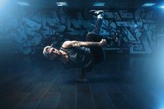 Breakdance performer posing in dance studio Stock Images