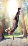 Breakdance performer, upside down motion in forest Stock Photography