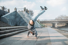 Breakdance performer, upside down motion on street Stock Images