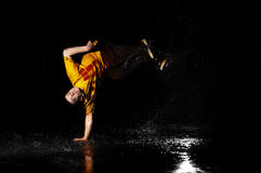 Breakdance style dancer in water. Stylish and cool breakdance style dancer in water Royalty Free Stock Images