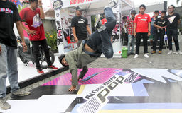 Breakdance. Teenagers are following breakdance competition in a sports center in the city of Solo, Central Java, Indonesia Royalty Free Stock Images
