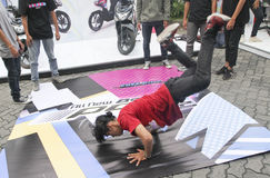 Breakdance. Teenagers are following breakdance competition in a sports center in the city of Solo, Central Java, Indonesia Royalty Free Stock Photography