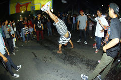 Breakdance. The teens dancing breakdance roadside on a night out in the city of Solo, Central Java, Indonesia Stock Photography