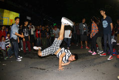 Breakdance. The teens dancing breakdance roadside on a night out in the city of Solo, Central Java, Indonesia Stock Photo
