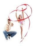 Breakdancer蹲坐和海明和优美的体操运动员女孩 库存图片