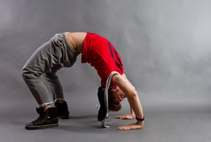 Breakdancer. Performing a dance move on the floor royalty free stock photography