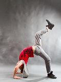 Breakdancer. Performing a dance move on the floor royalty free stock photos