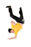 Breakdancer on arm. Young happy breakdancer standing upside down on arm stock photos