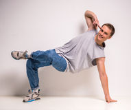 Breakdancer. Attractive young breakdancer showing his skills on white background Royalty Free Stock Photography