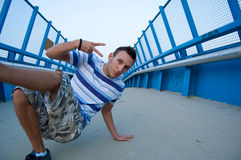 Breakdancer on blue bridge Stock Photo